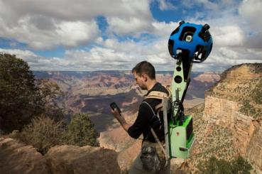 A Google employee, armed with a specialized Street View 360 degree camera, prepares to document the Grand Canyon. Photo Credit: Google.